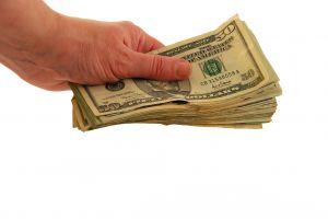 1037536_money_in_hand.jpg